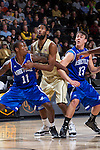 Marcus Neely (11) and David Robertson (13) of the UNC Asheville Bulldogs box out Aaron Rountree III (33) of the Wake Forest Demon Deacons during first half action at the LJVM Coliseum on November 14, 2014 in Winston-Salem, North Carolina.  The Demon Deacons defeated the Bulldogs 80-69  (Brian Westerholt/Sports On Film)