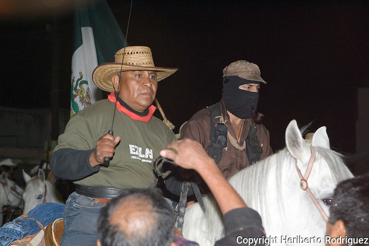 Zapatista rebel leder Subcomandante Marcos, the Delegado Zero, rides horseback along with San Salvador Atenco leaders, late April 25, 2006, in San Salvador Atenco in Mexico State, some 50 km from Mexico City. Subcomandante Marcos started a tour on January 1st, 2006, all over Mexico named The Other Campaign, meeting with different people and social organizations to organize an anticapitalist political program. Photo by Heriberto Rodriguez