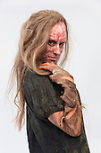 London, UK. 11 April 2015. Zombie-style makeup created by French makeup artist Harold Levy, Model Karine Rzepka. United Makeup Artists Expo (UMAe),  the UK's leading aspiring and professional hair and makeup artist trade show, gets underway at the Business Design Centre in Islington, London, UK. It runs until Sunday, 12 April. At this trade show leading professionals provide demonstrations and the latest techniques and products are showcased.