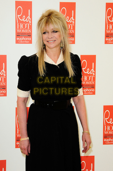 JO WOOD .attends Red magazine's 'Red Hot Women Awards' at the Saatchi Gallery, London, England, UK, .November 30th 2010..half length black dress white cream trim sleeves collar fringe .CAP/CAS.©Bob Cass/Capital Pictures.
