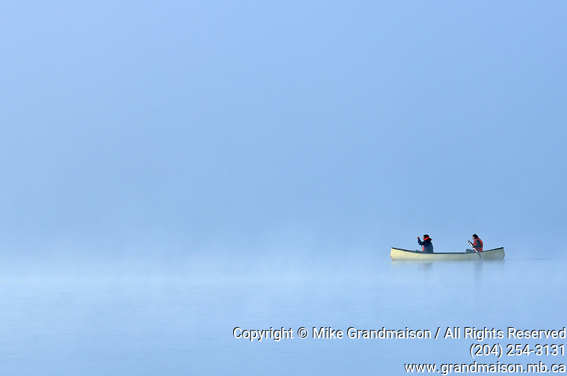 Canoeing in fog on Lake of Two Rivers<br />Algonquin Provincial Park<br />Ontario<br />Canada