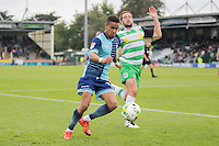 Paris Cowan-Hall of Wycombe Wanderers gets past Matthew Dolan of Yeovil Town gets during the Sky Bet League 2 match between Yeovil Town and Wycombe Wanderers at Huish Park, Yeovil, England on 8 October 2016. Photo by Mark  Hawkins / PRiME Media Images.