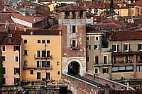 High angle view of the Torre di Guardia (Watch Tower), Il Ponte Pietra (Stone Bridge, Pons Marmoreus), 100 BC, across the Adige River, Verona, Italy. The Torre di Guardia was built in the 13th century by Alberto I della Scala to defend the bridge. Picture by Manuel Cohen.
