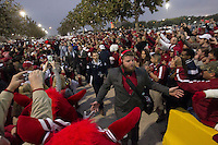Arkansas Democrat-Gazette/BENJAMIN KRAIN --12/29/2014--<br /> Brey Cook and other Razorback team members pass through a crowd of fans outside RNG Stadium in Houston before Monday night's Texas Bowl.