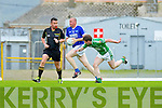 Milltown Mike Burke tries to stop Micheal Quirke Kerins O'Rahillys during their Senior Championship quarter final in Fitzgerald Stadium on Saturday