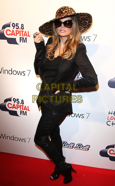 FERGIE aka STACY FERGUSON of BLACK EYED PEAS.At the 95.8 Capital FM Jingle Bell Ball in association with Windows 7,. O2 Arena, London , England, UK,.December 4th 2010..full length leopard brown print hat sunglasses hand on hip black jacket trousers peep toe open shoes boots ankle fur .CAP/ROS.©Steve Ross/Capital Pictures