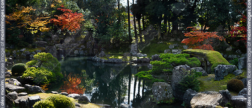 Panoramic scenery of a traditional Japanese Zen rock garden with a pond and a bridge leading to Fujito Ishi stones in the center, beautiful tranquil autumn scenery. Sanbo-in, Sanboin Buddhist temple, a sub-temple of Daigo-ji temple, Daigoji complex in Fushimi-ku, Kyoto, Japan 2017 Image © MaximImages, License at https://www.maximimages.com