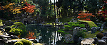 Panoramic scenery of a traditional Japanese Zen rock garden with a pond and a bridge leading to Fujito Ishi stones in the center, beautiful tranquil autumn scenery. Sanbo-in, Sanboin Buddhist temple, a sub-temple of Daigo-ji temple, Daigoji complex in Fushimi-ku, Kyoto, Japan 2017