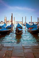 Gondolas at Piazza San Marco Venice with Isola di San Giorgio Maggiore and Gondolier in background