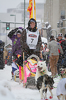 Wade Marrs leaves the 2011 Iditarod ceremonial start line in downtown Anchorage, during the 2012 Iditarod..Jim R. Kohl/Iditarodphotos.com