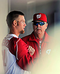4 March 2012: Washington Nationals pitcher Stephen Strasburg chats with Pitching Coach Steve McCatty after being taken out of the game in the third inning of a Spring Training game against the Houston Astros at Space Coast Stadium in Viera, Florida. Strasburg allowed two runs on three hits, striking out three in 2 2/3 innings as the Astros defeated the Nationals 10-2 in Grapefruit League action. Mandatory Credit: Ed Wolfstein Photo