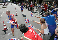 01 JUL 2007 - COPENHAGEN, DEN - British supporters hand out flags to team members as they reach the finish straight - European Age Group Triathlon Championships. (PHOTO (C) NIGEL FARROW)