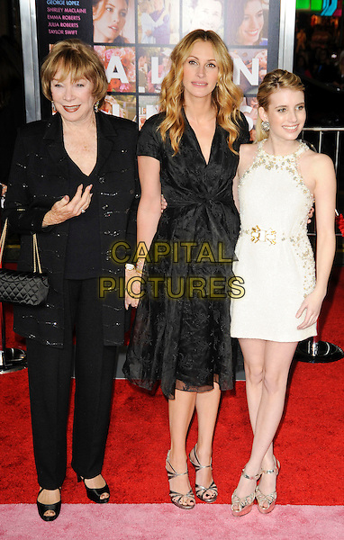 "SHIRLEY MacLAINE, JULIA ROBERTS & EMMA ROBERTS.The Los Angeles World Premiere of  ""Valentine's Day"" at Grauman's Chinese Theatre in Hollywood, California, USA..February 8th, 2010 .full length black dress white gold silver beads beaded trousers jacket lace niece aunt family .CAP/ROT.©Lee Roth/Capital Pictures"