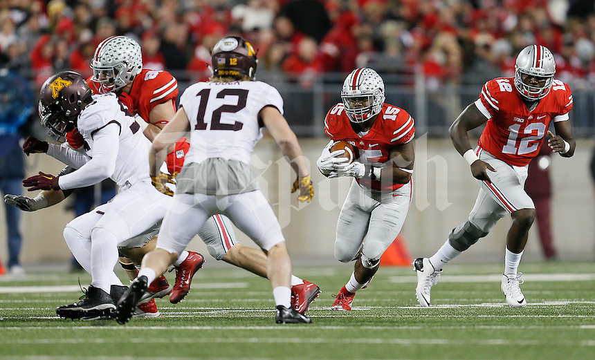 Ohio State Buckeyes running back Ezekiel Elliott (15) runs the ball in the third quarter of the college football game between the Ohio State Buckeyes and the Minnesota Golden Gophers at Ohio Stadium in Columbus, Saturday night, November 7, 2015. The Ohio State Buckeyes defeated the Minnesota Golden Gophers 28 - 14. (The Columbus Dispatch / Eamon Queeney)