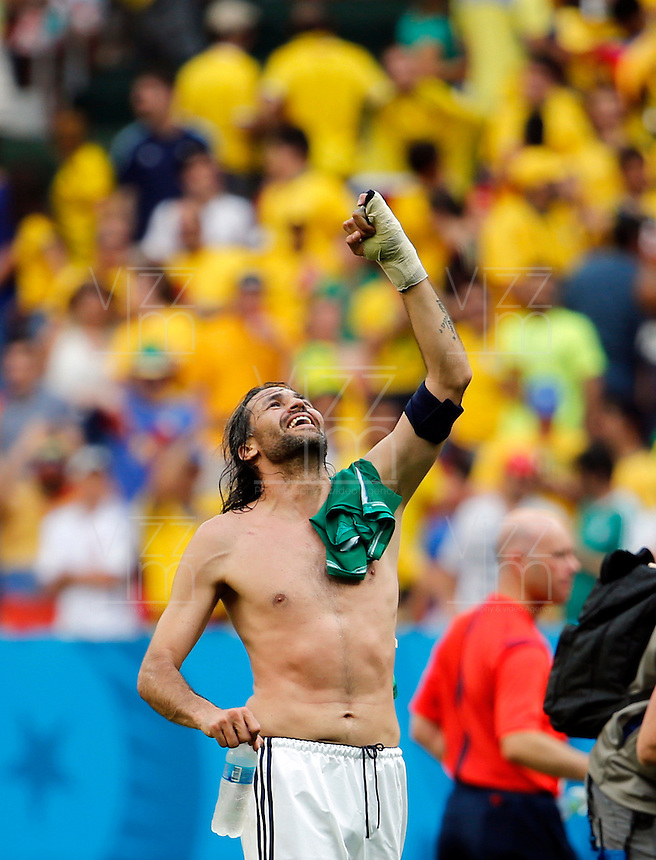 BRASILIA - BRASIL -19-06-2014. Foto: Daniel Jayo / Archivolatino<br /> Mario Yepes jugador de Colombia (COL) celebra la victoria sobre Costa de Marfil (CIV) en partido del Grupo C de la Copa Mundial de la FIFA Brasil 2014 jugado en el estadio Man&eacute; Garricha de Brasilia./ Mario Yepes player of Colombia (COL) celebrates the victory over Ivory Coast (CIV) in macth of the Group C of the 2014 FIFA World Cup Brazil played at Mane Garricha stadium in Brasilia. Photo:  Daniel Jayo / Archivo Latino<br /> VizzorImage PROVIDES THE ACCESS TO THIS PHOTOGRAPH ONLY AS A PRESS AND EDITORIAL SERVICE IN COLOMBIA AND NOT IS THE OWNER OF COPYRIGHT; ANOTHER USE IS REPONSABILITY OF THE END USER. NO SALES, NO MERCHANDASING. ALL COPYRIGHT IS ARCHIVOLATINO