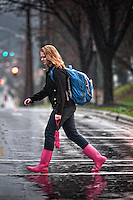An Otterbein College students walks under an umbrella  in the rain between classes during a fall rain storm.