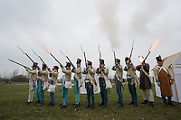 People dressed as Austrian soldiers in period dress attend the re-enactment of the historic battle Hungarian army fougth against Austrian soldiers of the Habsburg dynasty in Tapiobicske, 80 km (50 miles) southeast of Budapest, Hungary on April 04, 2013. ATTILA VOLGYI