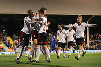Moussa Dembele and Liam Donnelly celebrate Fulham's third goal with goalscorer, Emerson Hyndman