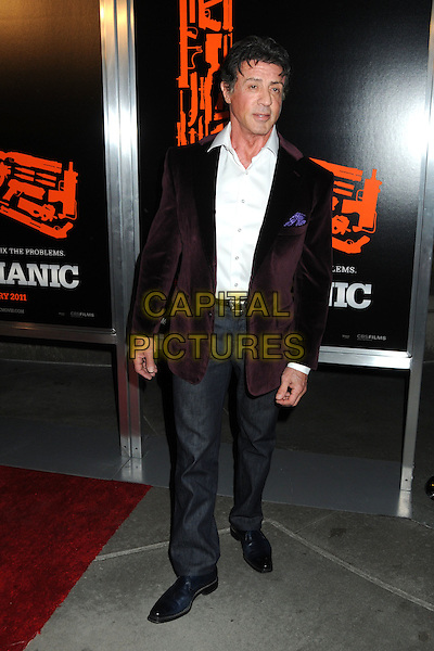 "SYLVESTER STALLONE .""The Mechanic"" Los Angeles Premiere held at Arclight Cinemas, Hollywood, California, USA, 25th January 2011..full length white sly shirt maroon burgundy jacket velvet blazer  grey gray trousers .CAP/ADM/BP.©Byron Purvis/AdMedia/Capital Pictures."