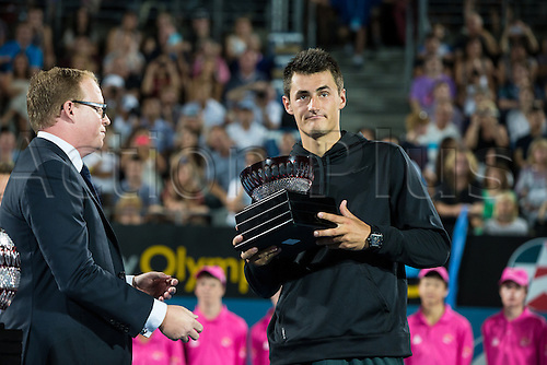 11.01.2014. Sydney Australia. Bernard Tomic receives his runners-up trophy at the  Mens Final, Apia International, Sydney Olympic Park Tennis Centre, Sydney, Australia, Saturday, 11 Jan 2014.