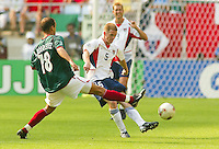 John O'Brien passes the ball. The USA defeated Mexico 2-0 in the Round of 16 of the FIFA World Cup 2002 in South Korea on June 17, 2002.