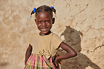 Chisland Selmond, 6, poses in front of her family's new home in Djondgon, a village near Jean-Rabel in northwestern Haiti. The family's previous house was destroyed during Hurricane Matthew in 2016, and Church World Service, a member of the ACT Alliance, helped the family build their sturdy new home.<br /> <br /> Parental consent obtained.