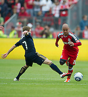 Philadelphia Union midfielder Brian Carroll #7 and Toronto FC defender Mikael Yourassowsky #19 in action during an MLS game between the Philadelphia Union and the Toronto FC at BMO Field in Toronto on May 28, 2011..The Philadelphia Union won 6-2..