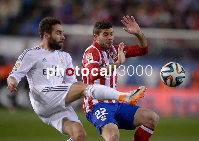 Real Madrid's defender Daniel Carvajal vies with Atletico Madrid's Argentinian defender Emiliano Insua during the Spanish Copa del Rey (King's Cup) semifinal second-leg football match Club Atletico de Madrid vs Real Madrid CF at the Vicente Calderon stadium in Madrid on February 11, 2014.   PHOTOCALL3000/ DP