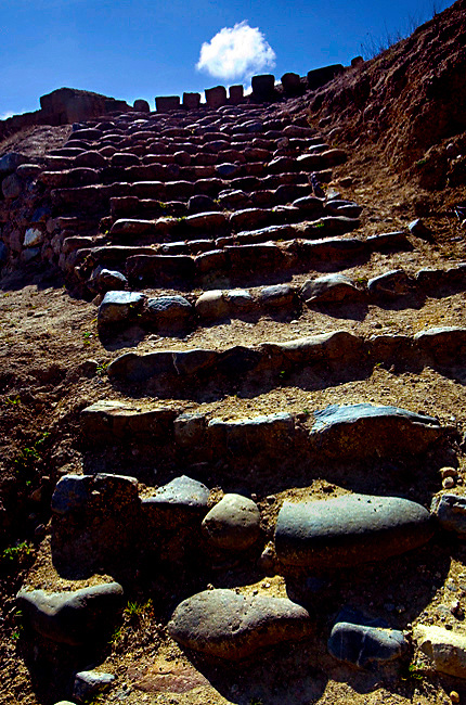 The worn stone steps constructed by the Incas, lead to Ecuador's most important Inca site, Ingapirca's Temple of the Sun.<br />