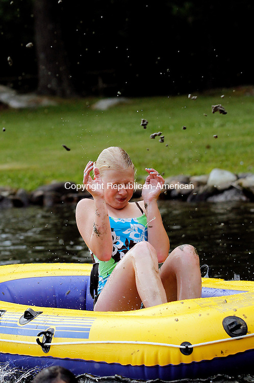 Goshen, CT- 28, June 2010-062810CM03  Eliza Porter, 12 of Goshen shields herself from mud, as she played with friends and family  at Woodridge Lake in Goshen Monday afternoon.  The group were enjoying their summer vacation, while taking advantage of the warm weather. The humidity is expected to let up today (Tuesday 6/29), with highs in the mid to upper 80's.  --Christopher Massa Republican-American