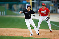 Niagara University Purple Eagles Tanner Kirwer (9) leads off first base in front of first baseman Zach Ratcliff (32) during a game against the Ohio State Buckeyes on February 20, 2016 at Holman Stadium at Historic Dodgertown in Vero Beach, Florida.  Ohio State defeated Niagara 10-7.  (Mike Janes/Four Seam Images)