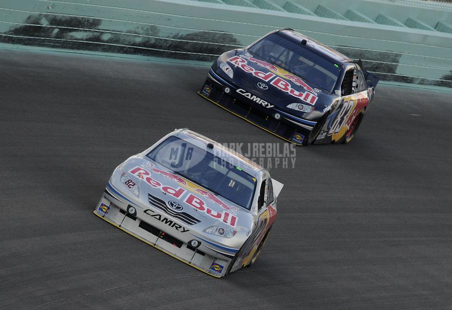 Nov. 21, 2010; Homestead, FL, USA; NASCAR Sprint Cup Series driver Scott Speed leads teammate Kasey Kahne during the Ford 400 at Homestead Miami Speedway. Mandatory Credit: Mark J. Rebilas-