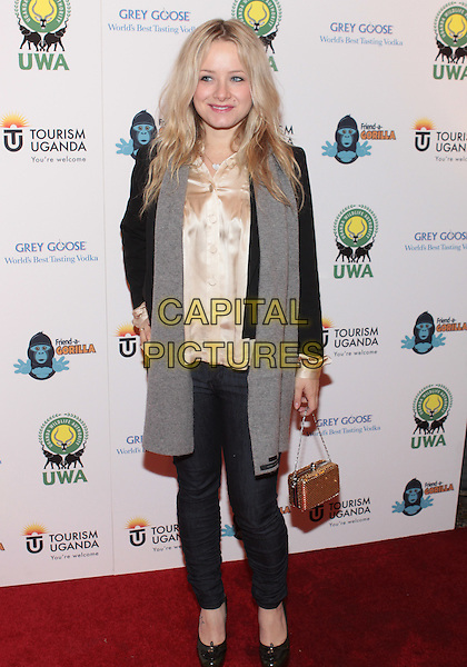 "SAMANTHA MOLLEN .Attending ""A Rumble In The Jungle Concrete Gala"" held at Sony Studios, Culver City, California, USA, .7th December 2009..full length grey gray scarf silk satin shirt top beige cream jeans .CAP/ADM/TC.©T. Conrad/AdMedia/Capital Pictures."