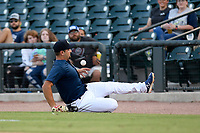 First baseman Chase Chambers (8) of the Columbia Fireflies slides chasing down a foul ball in a game against the Augusta GreenJackets on Saturday, June 1, 2019, at Segra Park in Columbia, South Carolina. Columbia won, 3-2. (Tom Priddy/Four Seam Images)