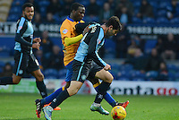 Wycombe Wanderers Joe Jacobson is challenged by Mansfield Town's Craig Westcarr during the Sky Bet League 2 match between Mansfield Town and Wycombe Wanderers at the One Call Stadium, Mansfield, England on 31 October 2015. Photo by Garry Griffiths.
