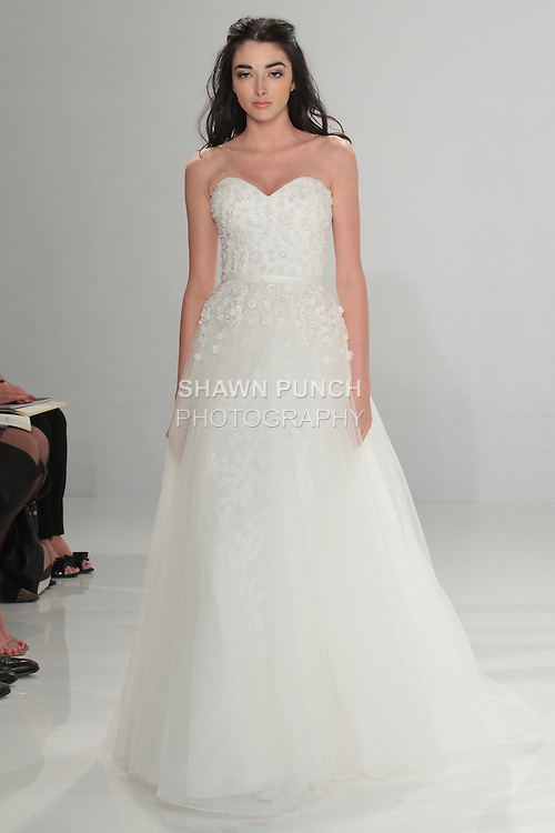 """Model walks runway in Juno - an off white A-line sweetheart tulle dress embellished with silk embroideries on the bodice and belted waist, from the Tony Ward Fall 2016 """"A Mid-Summer Night's Dream"""" bridal collection on April 18, 2016 at Kleinfeld Bridal during New York Bridal Fashion Week Spring Summer 2016."""