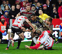 Semesa Rokoduguni of Bath Rugby takes on the Gloucester defence. Aviva Premiership match, between Gloucester Rugby and Bath Rugby on March 26, 2016 at Kingsholm Stadium in Gloucester, England. Photo by: Patrick Khachfe / Onside Images