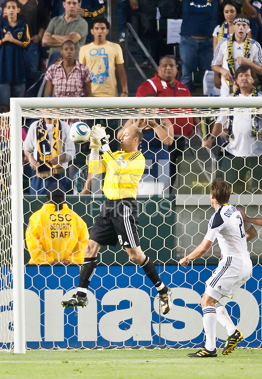 Seattle Sounders goalie Kasey Keller (18) jumps to catch a shot on goal during the first half of the game between LA Galaxy and the Seattle Sounders at the Home Depot Center in Carson, CA, on July 4, 2010. LA Galaxy 3, Seattle Sounders 1.