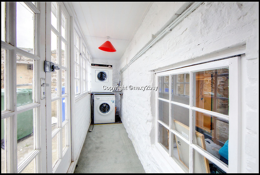BNPS.co.uk (01202 558833)<br /> Pic: next2buy/BNPS<br /> <br /> ***Please use full byline*** <br /> <br /> The utility room.<br /> <br /> An Englishman's home is his castle...<br /> <br /> An incredible property that looks like a miniature castle has come on the market for the bargain price of &pound;250,000.<br /> <br /> The Grade II listed building was erected in 1720 and features an amazing turret that boasts countryside and harbour views.<br /> <br /> It was originally used as a watch tower and the rest of the building was used as an office by the harbour master.<br /> <br /> The building, which is in Whitley Bay, Tyne and Wear, boasts four bedrooms, an open plan kitchen and dining room, and a spacious living room.<br /> <br /> It also has a yard at the back and is just a stone's throw away from the stunning coastal walk surrounding Colywell Bay.<br /> <br /> The property is being sold through Next2Buy estate agents who are based in Tyneside.