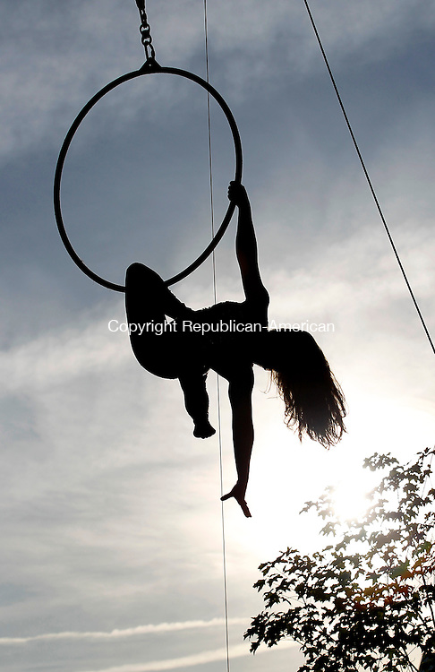 Oxford, CT-02, July 2010-070210CM08  Rosie Eastman, of Cristiani Brothers and Reid Imperial Circus, performs an acrobatics routine Friday night at the Quaker Farms Fire Company Carnival.  --Christopher Massa Republican-American