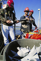 Employees of seismic vessel loading explosives on to boat. Employee of seismic vessel. Louisiana, Lake Salvador.