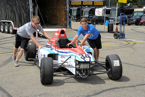 11-14 August, 2016, Lexington, Ohio USA<br /> Teammates, Michael Goodyear and Austin Kaszuba pushing car during setup day.<br /> ©2016 Dan R. Boyd<br /> LAT Photo USA