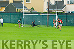 Kilcummin's Paul O'Shea send Stacks keeper Wayne Guthrie the wrong way as he converts from the penalty spot  in the Senior Club Football Championship