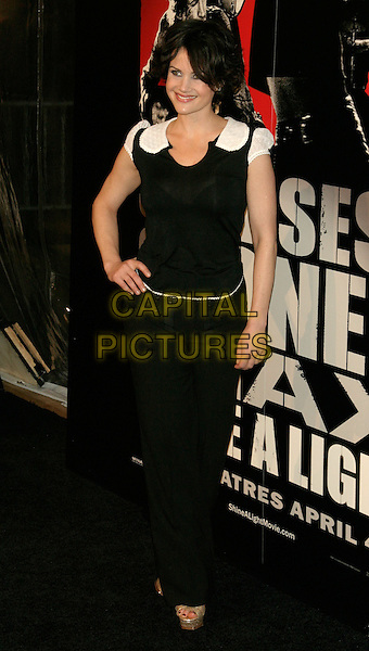 "CARLA GUGINO.New York Premiere of ""Shine A Light"" at the Ziegfeld Theater, New York, NY, USA..March 30th, 2008.full length black trousers top hand on hip white cap sleeves .CAP/LNC/TOM.©TOM/LNC/Capital Pictures."