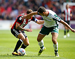 Billy Sharp of Sheffield Utd tussles with Matty Pearson of Barnsley during the Championship League match at Bramall Lane Stadium, Sheffield. Picture date 19th August 2017. Picture credit should read: Simon Bellis/Sportimage