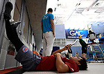 GREENSBORO, NC - MARCH 15: A Florida Southern Moc swimmer puts up his feet on deck during the Division II Men's and Women's Swimming & Diving Championship held at the Greensboro Aquatic Center on March 15, 2018 in Greensboro, North Carolina. (Photo by Mike Comer/NCAA Photos/NCAA Photos via Getty Images)