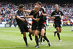 3 April 2004: Jaime Moreno (99) is mobbed by teammates Earnie Stewart (8), Alecko Eskandarian (middle), Dema Kovalenko (rear), and Mike Petke (12) after giving DC United a 1-0 lead with his goal in the 12th minute of the first half. DC United defeated the San Jose Earthquakes 2-1 at RFK Stadium in Washington, DC on opening day of the regular season in a Major League Soccer game..