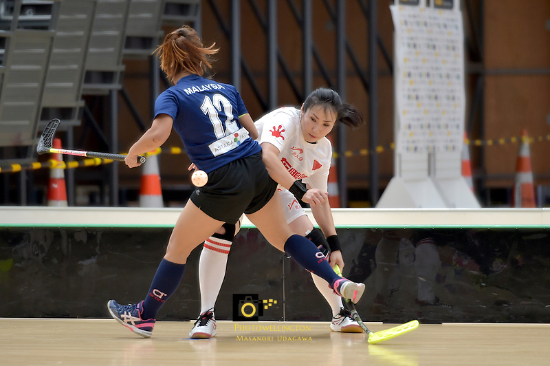 China's Ming Gong and Malaysia's Ivana Sonia Anak Beriak in action during the World Floorball Championships 2017 Qualification for Asia Oceania Region - Malaysia v China at ASB Sports Centre , Wellington, New Zealand on Sunday 5 February 2017.<br /> Photo by Masanori Udagawa<br /> www.photowellington.photoshelter.com.