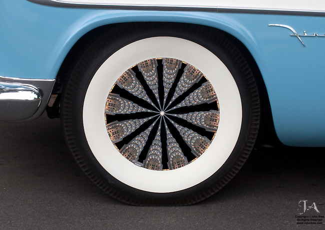 Fine Art shot of the Chrysler Building finding its way into the spokes of a 1950's DeSoto