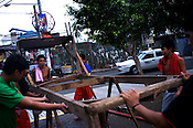 Filipino youth move the makeshift basketball post before their game at the Remedios circle in Malate, Manila in Philippines. Photo: Sanjit Das